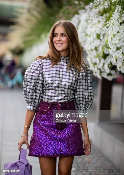 Nina Sandbech wearing silver Ganni top and purple Acne mini skirt purple bag is seen during Stockholm Runway SS19 on August 28 2018 in Stockholm...