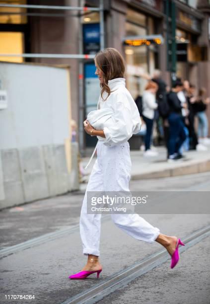 Nina Sandbech wearing white pants button shirt during Oslo Fushion on August 28 2019 in Oslo Norway
