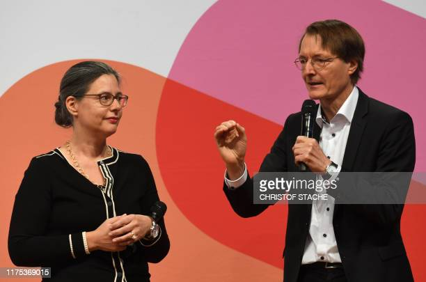Nina Scheer and Karl Lauterbach , candidates as chairman for the Social Democratic Party SPD, speak on the stage during the last regional SPD...