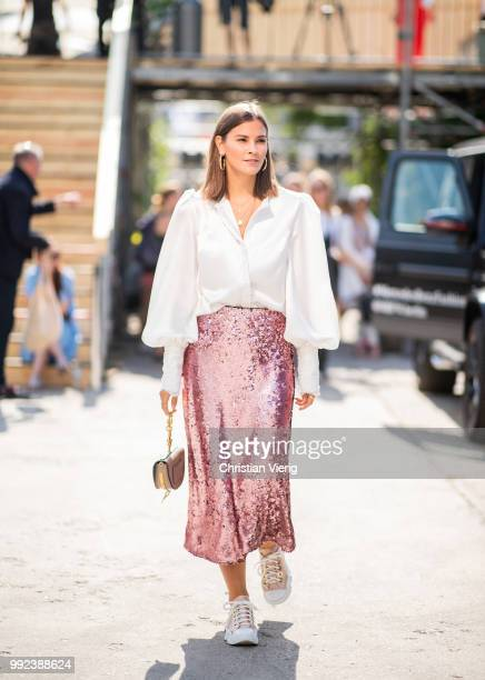 Nina Schwichtenberg wearing high waist pink glitter white button shirt Chloe bag is seen outside Lana Mueller during the Berlin Fashion Week July...