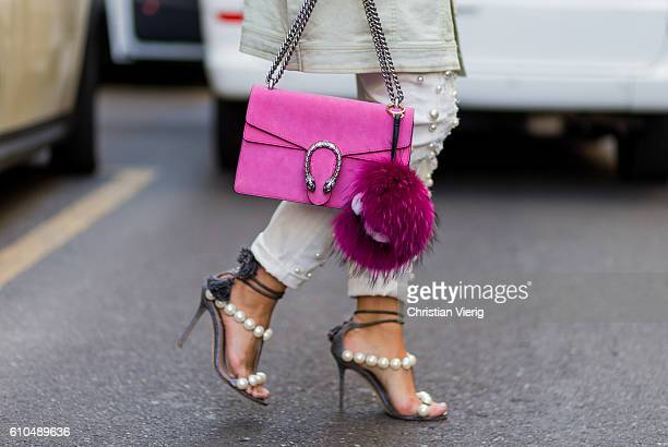 Nina Schwichtenberg wearing pink Gucci bag pants and heels with pearls outside Dolce Gabbana during Milan Fashion Week Spring/Summer 2017 on...