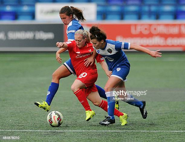 Nina Smorsgard of Liverpool Ladies competes with Angharad James and Hannah Short of Bristol Academy Women during the Womens Super League match...