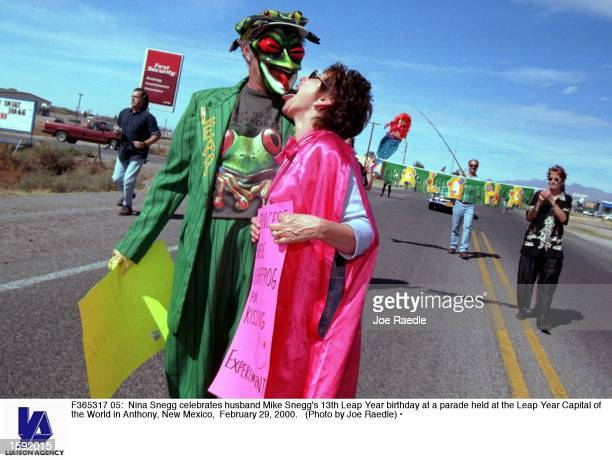 Nina Snegg celebrates husband Mike Snegg's 13th Leap Year birthday at a parade held at the Leap Year Capital of the World in Anthony, New Mexico,...
