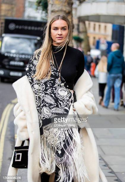 Nina Suees is seen wearing black turtleneck, teddy coat, black bucket bag, boots outside Erdem during London Fashion Week February 2020 on February...