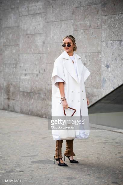 Nina Suess is seen wearing a white coat and beige pants outside Max Mara on Day 2 Milan Fashion Week Autumn/Winter 2019/20 on February 21 2019 in...