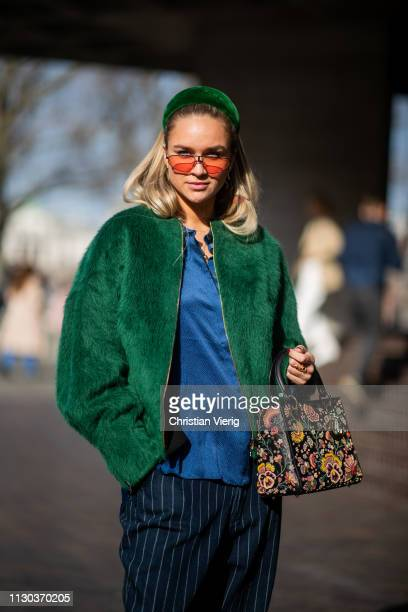 Nina Suess is seen wearing green hair hoop striped pants green jacket bag with floral print outside Roland Mouret during London Fashion Week February...
