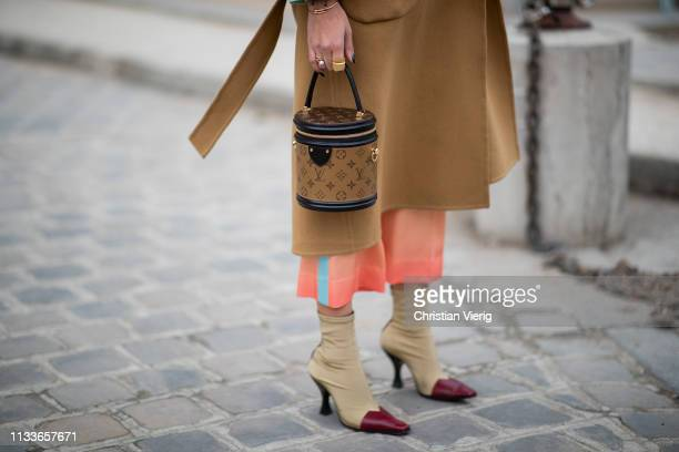 Nina Suess is seen wearing Louis Vuitton bag brown coat outside Akris during Paris Fashion Week Womenswear Fall/Winter 2019/2020 on March 03 2019 in...