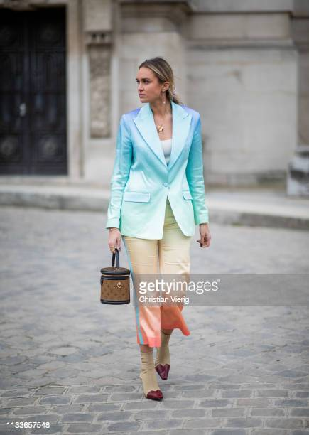 Nina Suess is seen wearing Louis Vuitton bag, colored blazer and skirt outside Akris during Paris Fashion Week Womenswear Fall/Winter 2019/2020 on...