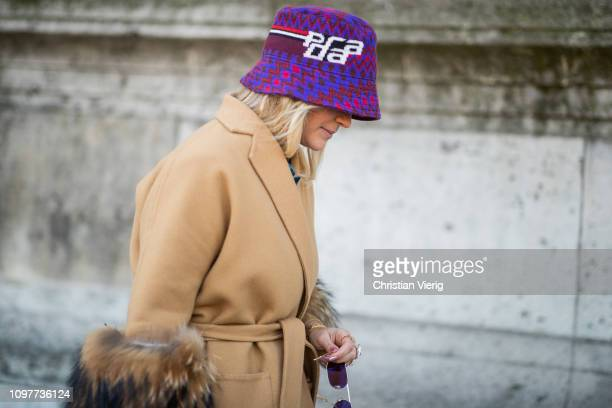 Nina Suess is seen wearing purple Prada bucket hat beige wool coat outside Iris Van Herpen during Paris Fashion Week Haute Couture Spring Summer 2019...