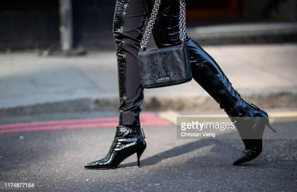 Nina Suess is seen wearing total look Marc Cain: black bag, black vinyl pants, ankle boots, blazer during London Fashion Week September 2019 on...