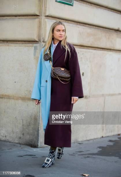 Nina Suess is seen wearing turqouis bordeaux two tone coat Louis Vuitton belt bag outside Redemption during Paris Fashion Week Womenswear Spring...