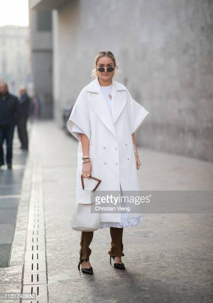 Nina Suess is seen wearing white coat without sleeves outside Max Mara on Day 2 Milan Fashion Week Autumn/Winter 2019/20 on February 21 2019 in Milan...