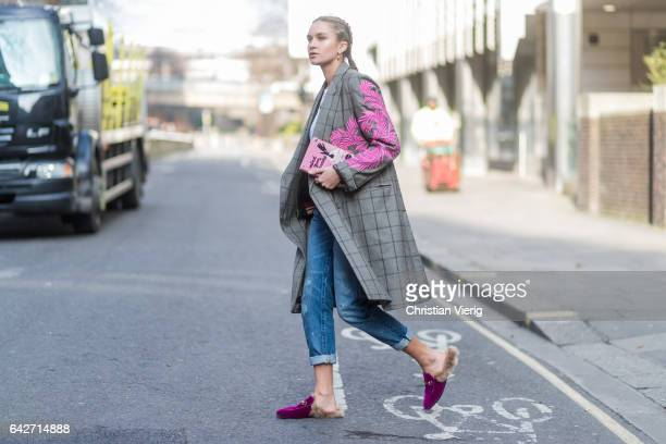 Nina Suess wearing a checked coat Gucci loafers cropped denim jeans outside Julien Macdonald on day 2 of the London Fashion Week February 2017...