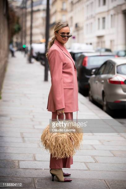 Nina Suess wearing a pink suit beige boots and beige bag is seen outside Elie Saab on Day 6 Paris Fashion Week Autumn/Winter 2019/20 on March 2 2019...