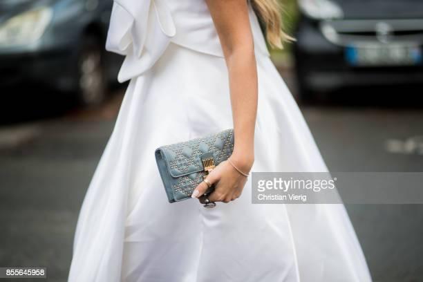 Nina Suess wearing a white dress a Dior bag is seen outside Emanuel Ungaro during Paris Fashion Week Spring/Summer 2018 on September 29 2017 in Paris...