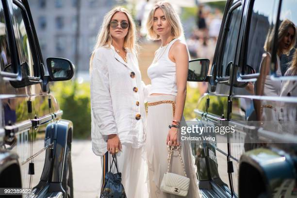 Nina Suess wearing linen button shirt and Lisa Hahnbueck wearing ruffled maxi skirt white top white Chanel bag seen outside Lana Mueller during the...