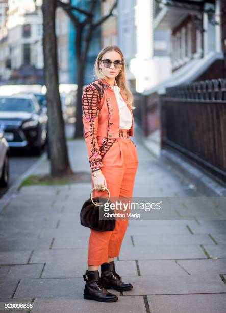 Nina Suess wearing orange pants and jacket velvet brown bag seen outside Temperley London during London Fashion Week February 2018 on February 18...