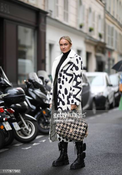 Nina Suess wearing Prada boots and Chanel bag on September 29 2019 in Paris France