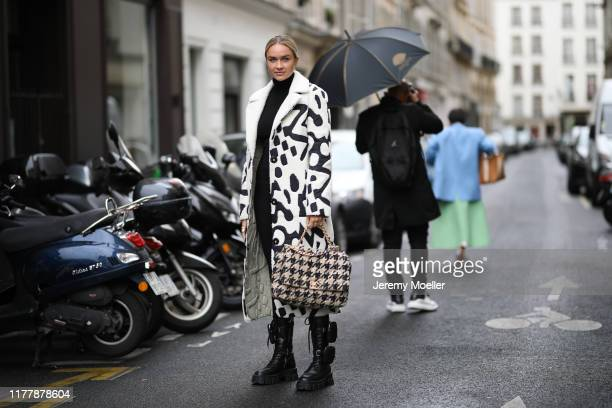 Nina Suess wearing Prada boots and Chanel bag on September 29, 2019 in Paris, France.