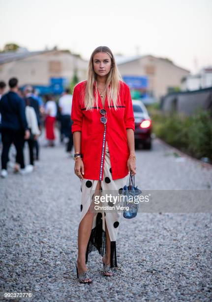 Nina Suess wearing red jacket skirt with dots print is seen at HUGO during the Berlin Fashion Week July 2018 on July 5 2018 in Berlin Germany