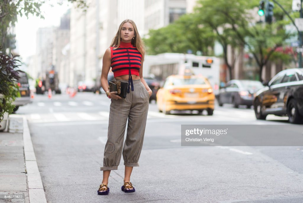 Nina Suess wearing striped sleevless top Fendi, cropped pants Fendi, Fendi bag, Prada sandals seen in the streets of Manhattan during New York Fashion Week on September 12, 2017 in New York City.