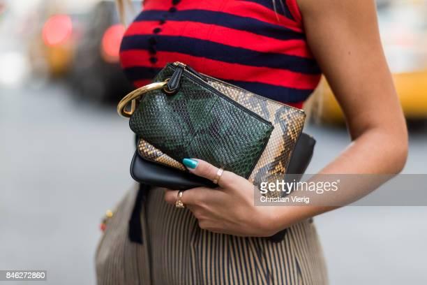 Nina Suess wearing striped sleevless top Fendi cropped pants Fendi Fendi bag Prada sandals seen in the streets of Manhattan during New York Fashion...
