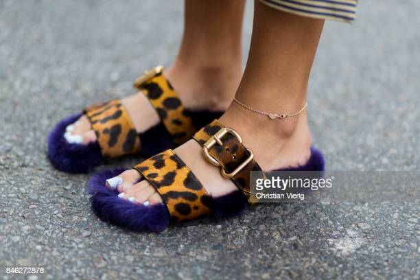 Nina Suess wearing striped sleevless top Fendi cropped pants Fendi Fendi bag Prada sandals seen in the streets of Manhattan during New York Fashion...