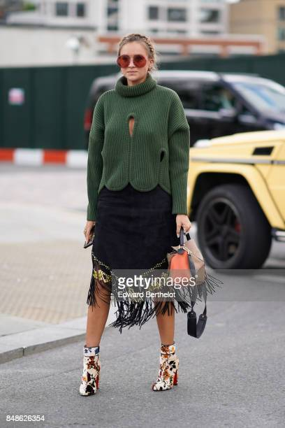 Nina Suess wears a green turtleneck pull over outside Versus during London Fashion Week September 2017 on September 17 2017 in London England