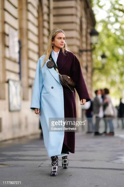 Nina Suess wears earrings a Louis Vuitton monogram bag and a Louis Vuitton monogram tiny round canteen bag a halfblue and halfdark plum color...