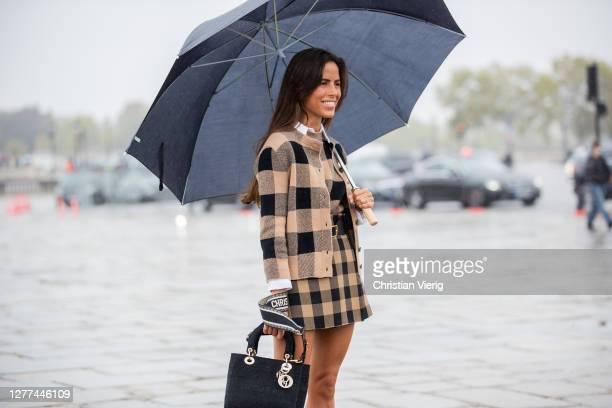 Nina Urgell Cloquell seen wearing beige checkered skirt, jacket outside Dior during Paris Fashion Week - Womenswear Spring Summer 2021 : Day Two on...