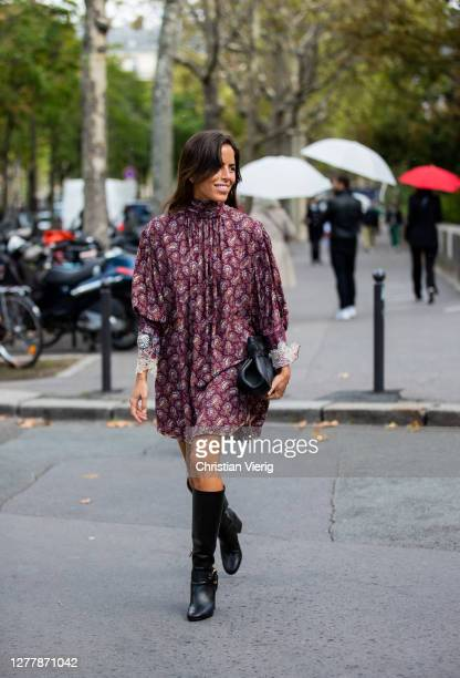 Nina Urgell Cloquell seen wearing dress with print, black bag outside Chloe during Paris Fashion Week - Womenswear Spring Summer 2021 : Day Four on...