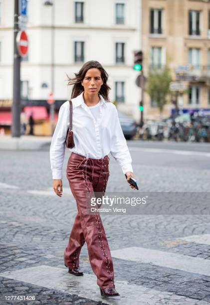 Nina Urgell Cloquell seen wearing white button shirt, brown bag, red pants outside Coperni during Paris Fashion Week - Womenswear Spring Summer 2021...