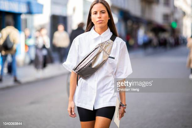Nina Urgell Cloquell wearing Prada fanny bag cycle pants is seen outside Jacquemus during Paris Fashion Week Womenswear Spring/Summer 2019 on...