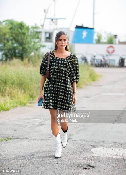 Nina Urquell Cloquell is seen wearing black green dress outside Cecilie Bahnsen during Copenhagen Fashion Week Spring/Summer 2020 on August 07, 2019...