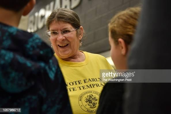 Nina Uzick, C, an election judge with Montgomery County ... |County Committee Hiers Nina
