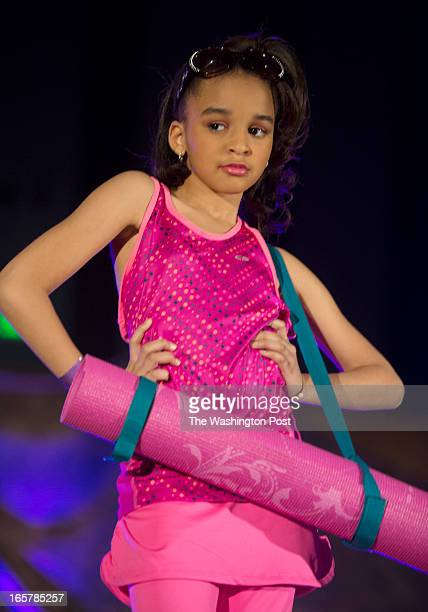 Nina Waters shows off a yoga oufit complete with a yoga mat on stage during the 3rd Annual Glynn Jackson's Show Biz Kidz at The Silver Spring Civic...