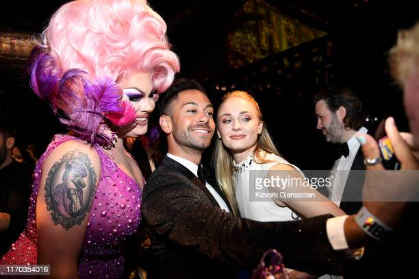 Nina West and Sophie Turner get their photograph taken by a guest during HBO's Post Emmy Awards Reception on September 22 2019 in Los Angeles...