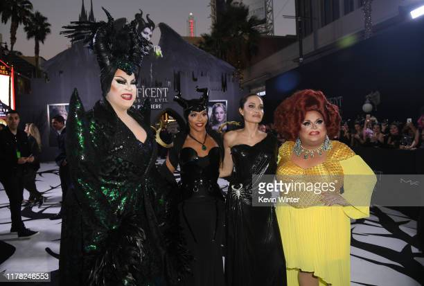 """Nina West, Shangela, Angelina Jolie, and Ginger Minj attend the world premiere of Disney's """"Maleficent: Mistress Of Evil"""" at El Capitan Theatre on..."""