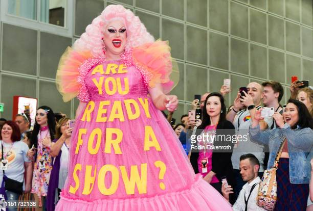 Nina West walks down the pink carpet at RuPaul's DragCon LA 2019 at Los Angeles Convention Center on May 25 2019 in Los Angeles California