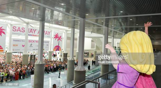 Nina West waves to attendees waiting to be admitted into RuPaul's DragCon LA 2019 at Los Angeles Convention Center on May 25 2019 in Los Angeles...