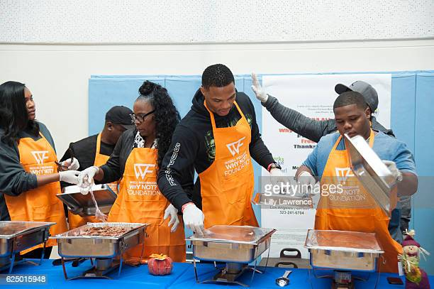 Nina Westbrook Shannon Westbrook Russell Westbrook and Ray Westbrook serve Thanksgiving dinner at Russell Westbrook and Why Not Foundation Host 5th...