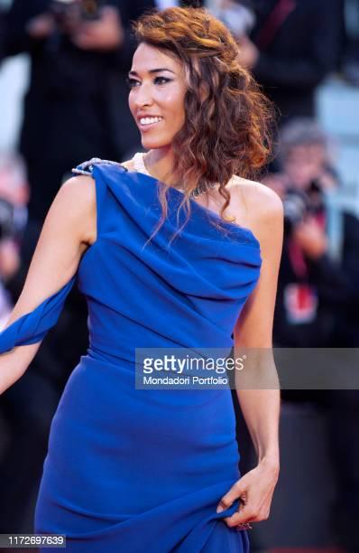 "Nina Zilli walks the red carpet ahead of the ""Gloria Mundi"" screening during the 76th Venice Film Festival at Sala Grande on September 05, 2019 in..."