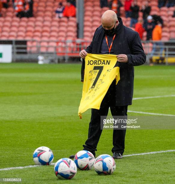 Nine balls are placed on the pitch in tribute to nine-year-old Jordan Banks, who was struck by lightning and killed, before the Sky Bet League One...