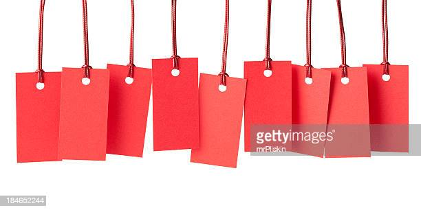 Nine blank red price labels