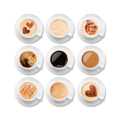 Nine different coffees in white cups with saucers 182783220