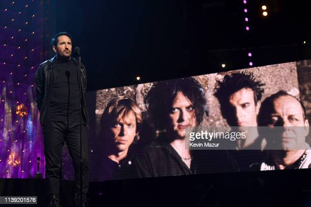 Nine Inch Nails' Trent Reznor presents The Cure onstage at the 2019 Rock Roll Hall Of Fame Induction Ceremony Show at Barclays Center on March 29...