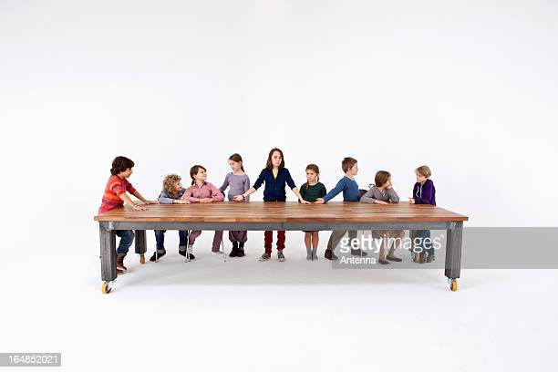 Nine kids arranged to imitate Leonardo Da Vinci's The Last Supper