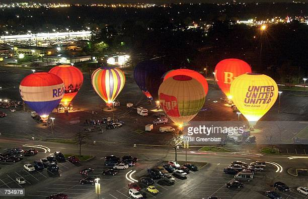 Nine large balloons entertain the early crowds that have come to see the Salvation Army Balloon Glow at an area shopping mall November 11 2000 in St...