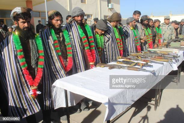 Nine members of Taliban line up after they laid down arms and surrendered in Jowzjan Afghanistan on January 01 2017