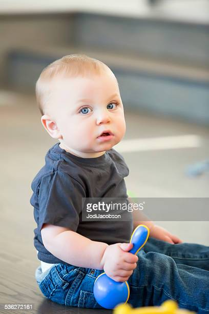 Nine month old caucasian boy playng with toysl